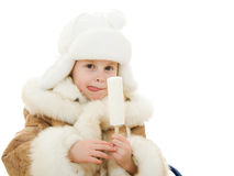 The girl in warm clothes eating ice cream Royalty Free Stock Images