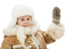 Girl in warm clothes kindly waving a hand Royalty Free Stock Image