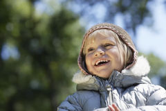 Girl In Warm Clothes Laughing At Yard Royalty Free Stock Images