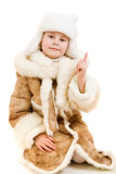 The girl in warm clothes points a finger upward Royalty Free Stock Photography