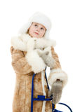 The girl in warm clothes with a sledge Stock Photo