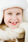 The girl in warm clothes smiling Royalty Free Stock Image
