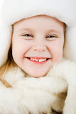The girl in warm clothes smiling Royalty Free Stock Photo