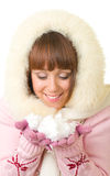 Girl in warm clothes with snow Royalty Free Stock Image