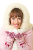 Girl in warm clothes with snow Royalty Free Stock Images