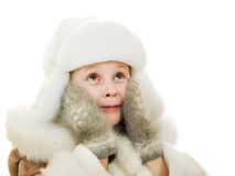 The girl in warm clothes in surprise looking up Royalty Free Stock Photos