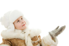 Girl in warm clothes in surprise looking up Royalty Free Stock Photo