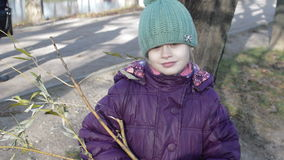 Girl in warm clothes walks in the Park stock video footage