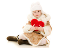 Girl in warm clothing holding the heart Royalty Free Stock Images