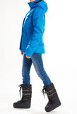 Girl in warm down jacket and moon boots. Royalty Free Stock Images