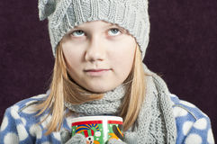 Girl with a warm drink Stock Image