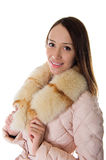 A girl in a warm jacket Stock Images