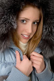 The girl in  warm jacket with a hood Stock Image