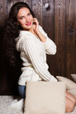 Girl in warm knitted handmade clothes at home. Royalty Free Stock Photo