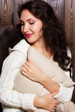 Girl in warm knitted handmade clothes at home. Royalty Free Stock Photography