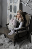 Girl in warm knitted things in the chair Stock Image
