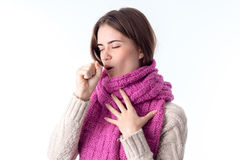 Girl in a warm scarf coughs isolated on white background Stock Image