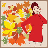 Girl in a warm sweater against autumn leaves Stock Photo