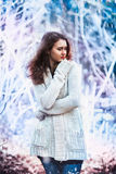 Girl in warm sweater on the winter background Royalty Free Stock Photography