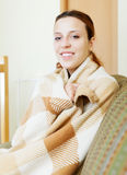 Girl warming in plaid at home Stock Photos