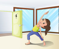 A girl warming up in a room Royalty Free Stock Image