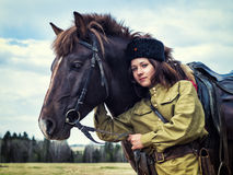 Girl warrior Cossack with a horse. Portrait. Royalty Free Stock Photography