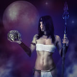 Girl warrior fantasy. A mystical portrait with a skull. Beautiful girl in image of the ancient barbarian warrior on a mystical background with a skull in his stock photos