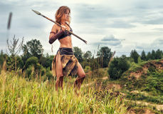 Girl warrior in the field. Amazon on patrol Royalty Free Stock Photo