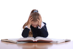 Girl was declined above the book Royalty Free Stock Photos