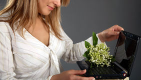 Girl was given a laptop with flowers Stock Photos