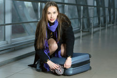 Girl was scattered luggage in transit Royalty Free Stock Images