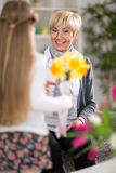 Girl was surprised his grandmother with flowers Stock Photography