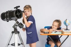 The girl was upset he did not see in telescope, the other girl mocking her Stock Photo