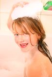 Girl wash hair Stock Images