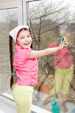 Girl wash window Stock Images