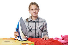 Girl with washed linen around ironing board and iron isolated Royalty Free Stock Photography