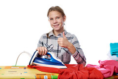 Girl with washed linen around ironing board and iron isolated Royalty Free Stock Photos