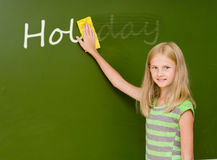 Girl washes away from the chalkboard word Stock Photo