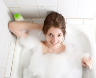 Girl washes in a bath royalty free stock photo