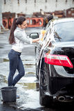 Girl washes the car stock photo