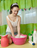 Girl washes clothes Stock Image