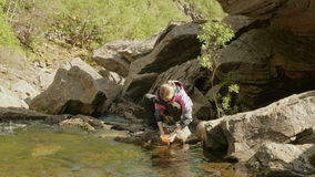 Girl washes the dishes outdoors stock footage