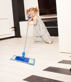 Girl washes a floor mop Royalty Free Stock Photos