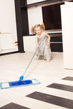 Girl washes a floor mop Royalty Free Stock Photo