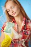 Girl washes the glass Stock Images