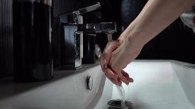 The girl washes her hands. Close-up stock video footage