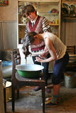 Girl washes his head in an enamel basin,  farmhouse Russia. Stock Photography