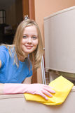 Girl washes refrigerator Royalty Free Stock Image