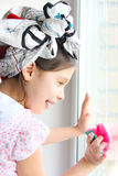 The girl washes the window Royalty Free Stock Photo