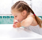 Girl washing in bath. Cute little girl washing in bath Royalty Free Stock Photo